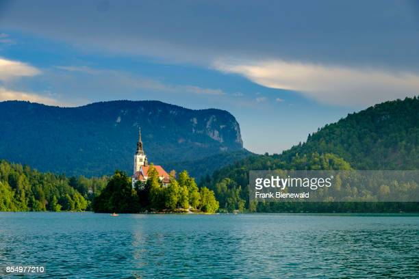 Bled Island Blejski otok with the pilgrimage church dedicated to the Assumption of Mary seen across Lake Bled Blejsko jezero