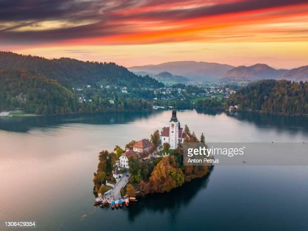 bled lake at sunset aerial view, bled, slovenia - bledsjön bildbanksfoton och bilder