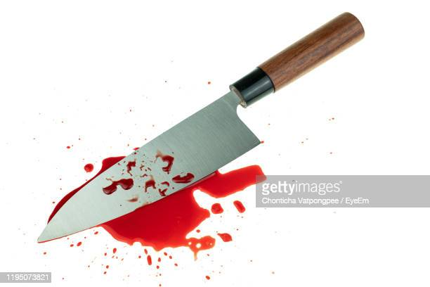 bleeding red blood from the cut finger wound at white background - kitchen knife stock pictures, royalty-free photos & images