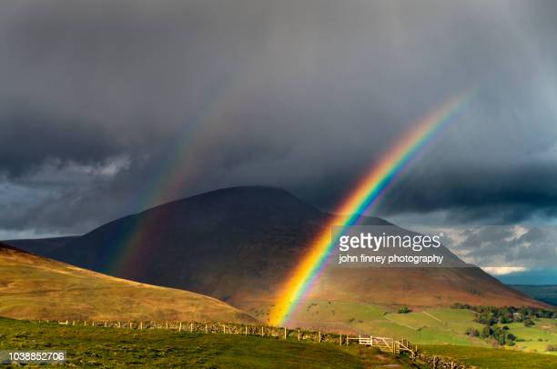 blencathra double rainbow, lake district. uk - rainbow sky stock pictures, royalty-free photos & images