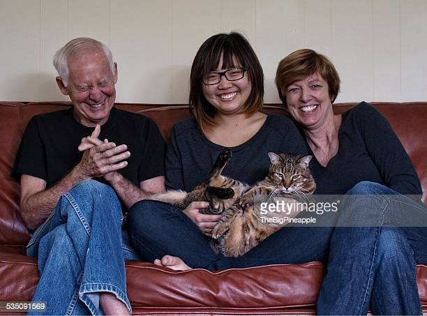 Blended family of three on couch with pet cat