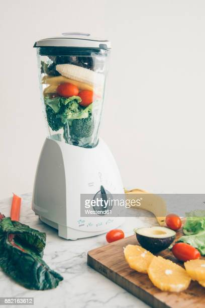 Blender filled with fruit and vegetable