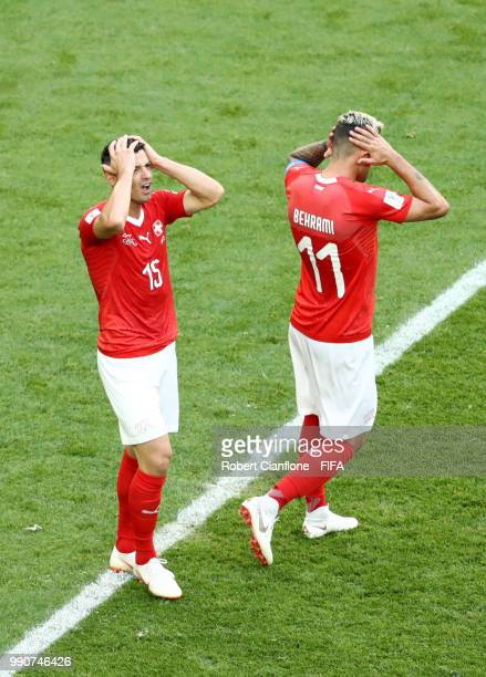 Blerim Dzemaili and Valon Behrami of Switzerland react during the 2018 FIFA World Cup Russia Round of 16 match between Sweden and Switzerland at...