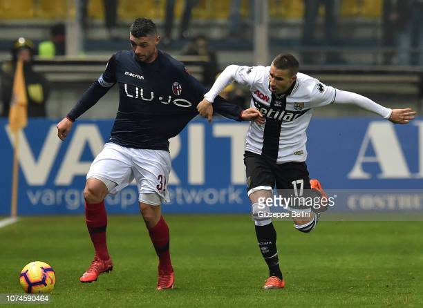 Blerim Dzemaili of Bologna FC and Antonino Barillà of Parma Calcio in action during the Serie A match between Parma Calcio and Bologna FC at Stadio...