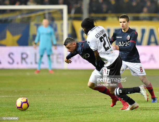 Blerim Dzemaili of Bologna FC and Gervinho of Parma Calcio in action during the Serie A match between Parma Calcio and Bologna FC at Stadio Ennio...
