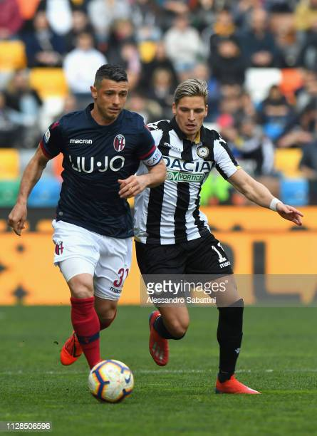 Blerim Dzemaili of Bologna FC competes for the ball with Bram Nuytinck of Udinese Calcio during the Serie A match between Udinese and Bologna FC at...