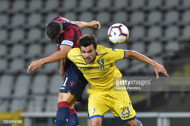 Blerim Dzemaili of Bologna FC competes for the ball with Nicolo' Brighenti of Frosinone Calcio during the serie A match between Frosinone Calcio and...