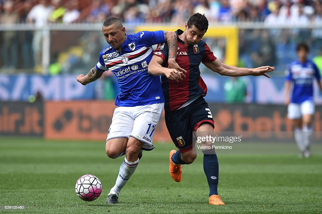 Blerim Dzemaili (R) of Genoa CFC is challenged by Angelo Palombo of UC Sampdoria during the Serie A match between UC Sampdoria and Genoa CFC at Stadio Luigi Ferraris on May 8, 2016 in Genoa, Italy.