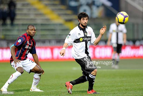 Blerim Dzemaili of Parma FC competes for the ball with Gabi Mudingayi of Bologna FC during the Serie A match between Parma and Bologna at Stadio...
