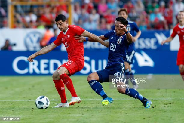 Blerim Dzemaili of Switzerland and Tomoaki Makino of Japan battle for the ball during the international friendly match between Switzerland and Japan...