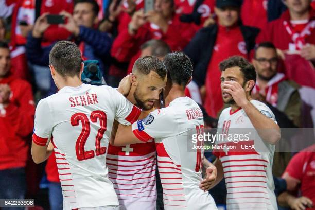 Blerim Dzemaili of Switzerland celebrates his goal with team mates during the FIFA 2018 World Cup Qualifier between Latvia and Switzerland at Skonto...