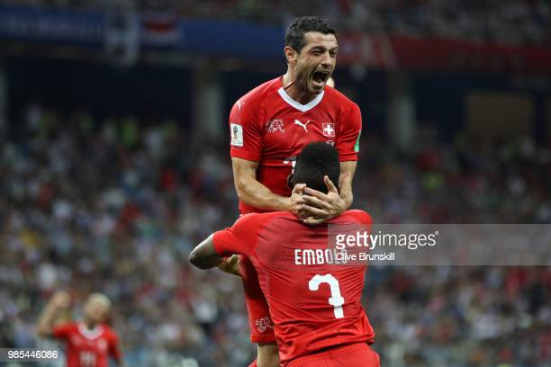 Blerim Dzemaili of Switzerland celebrates with teammate Breel Embolo after scoring his team's first goal during the 2018 FIFA World Cup Russia group...