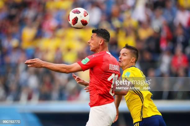 Blerim Dzemaili of Switzerland competes with Mikael Lustig of Sweden during the 2018 FIFA World Cup Russia Round of 16 match between Sweden and...