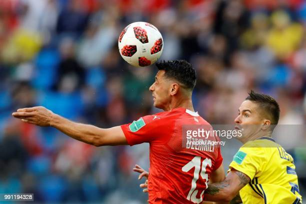 Blerim Dzemaili of Switzerland in action against Mikael Lustig of Sweden during the 2018 FIFA World Cup Russia Round of 16 match between Sweden and...