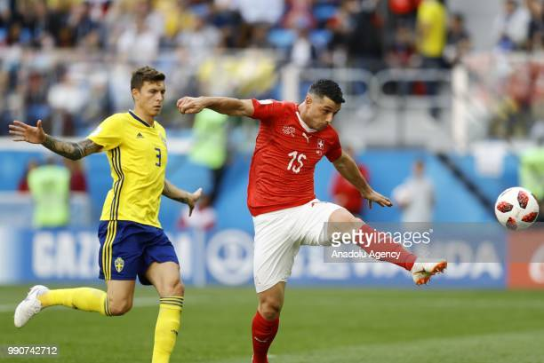 Blerim Dzemaili of Switzerland in action against Victor Lindelof of Sweden during the 2018 FIFA World Cup Russia Round of 16 match between Sweden and...
