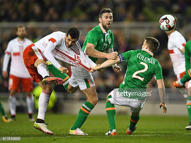 Blerim Dzemaili of Switzerland is challenged by Daryl Murphy and Seamus Coleman of Republic of Ireland during the International Friendly match...