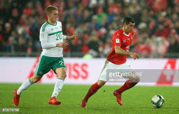 Blerim Dzemaili of Switzerland is closed down by George Saville of Northern Ireland during the FIFA 2018 World Cup Qualifier PlayOff Second Leg...