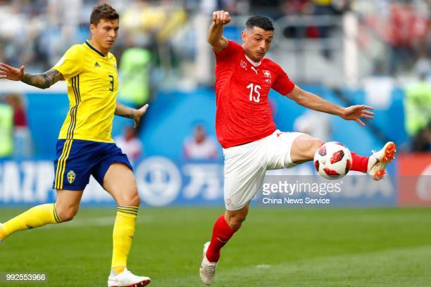 Blerim Dzemaili of Switzerland kicks the ball during the 2018 FIFA World Cup Russia Round of 16 match between Sweden and Switzerland at the Saint...