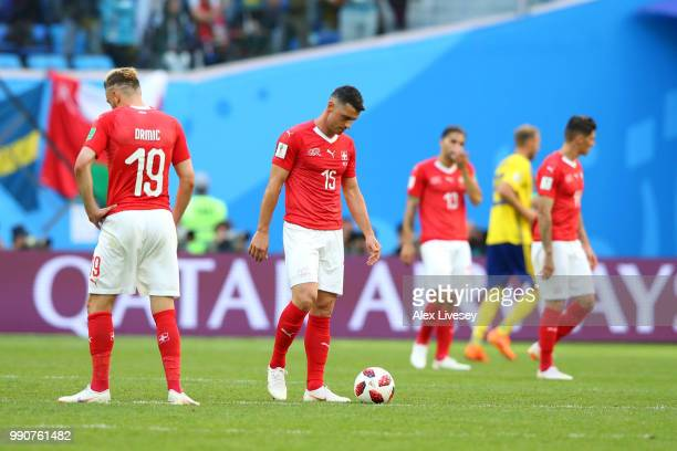 Blerim Dzemaili of Switzerland looks dejected after his side concede during the 2018 FIFA World Cup Russia Round of 16 match between Sweden and...