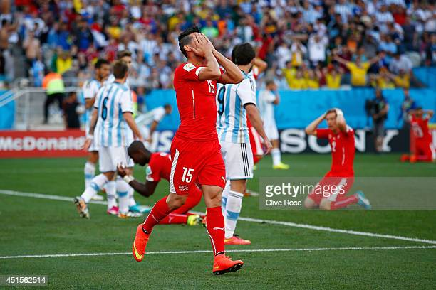 Blerim Dzemaili of Switzerland reacts after a missed chance at goal during the 2014 FIFA World Cup Brazil Round of 16 match between Argentina and...