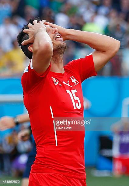 Blerim Dzemaili of Switzerland reacts after a missed chance in extra time during the 2014 FIFA World Cup Brazil Round of 16 match between Argentina...