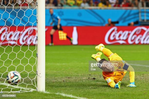 Blerim Dzemaili of Switzerland scores his team's first goal past Hugo Lloris of France during the 2014 FIFA World Cup Brazil Group E match between...