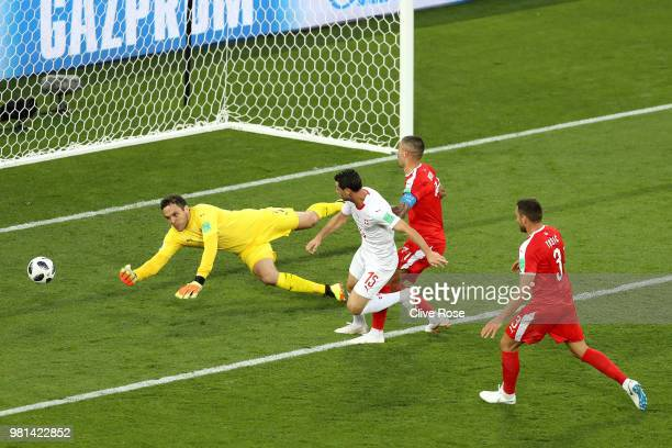 Blerim Dzemaili of Switzerland shoots under pressure from Aleksandar Kolarov of Serbia and Dusko Tosic of Serbia during the 2018 FIFA World Cup...