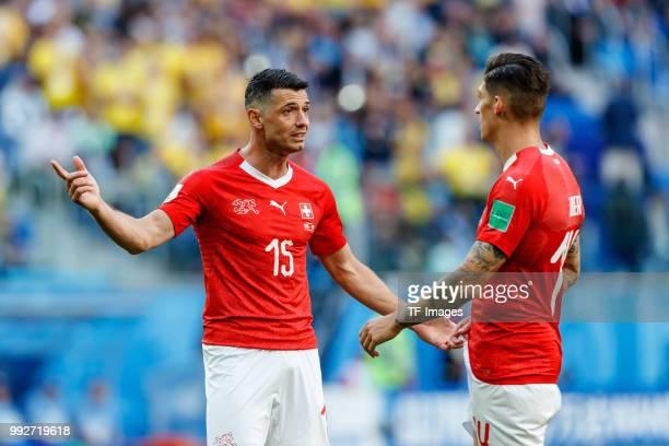 Blerim Dzemaili of Switzerland speaks with Steven Zuber of Switzerland during the 2018 FIFA World Cup Russia Round of 16 match between Sweden and...