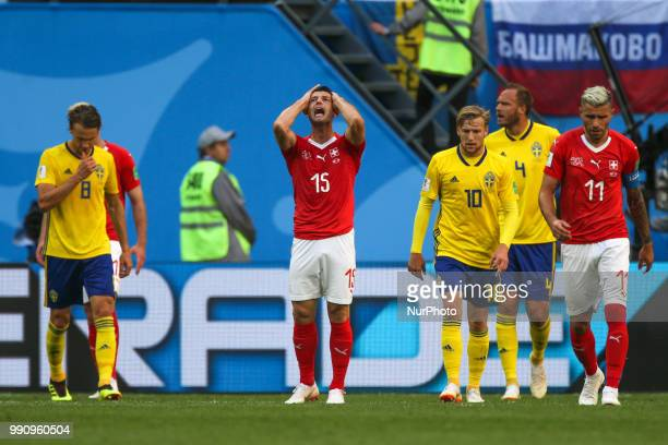 Blerim Dzemaili of the Switzerland national football team reacts during the 2018 FIFA World Cup match Round of 16 between Sweden and Switzerland at...