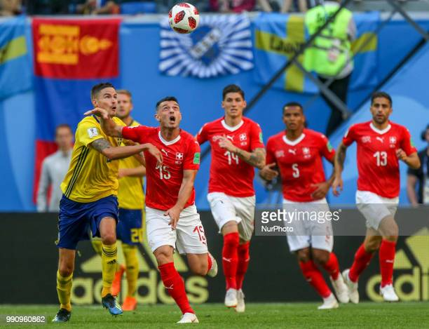 Blerim Dzemaili of the Switzerland national football team vie for the ball during the 2018 FIFA World Cup match Round of 16 between Sweden and...