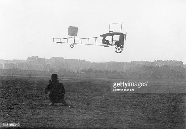 Bleriot Louis Engineer Aviator F *01071872 An early French aeroplane built by Louis Bleriot on its fligth of 800 meters on bord Bleriot his wife and...