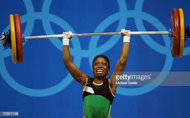 Blessed Udoh of Nigeria struggles under the weight in the women's 48 kg category weightlifting competition on August 14 2004 during the Athens 2004...