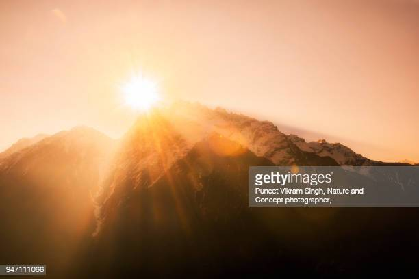 blessing light rays from the mountain peak - religious blessing stock pictures, royalty-free photos & images