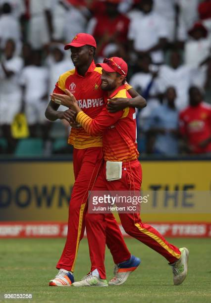 Blessing Muzarabani and Sean Ervine of Zimbabwe celebrate the wicket of Shaiman Anwar of the UAE during The ICC Cricket World Cup Qualifier between...