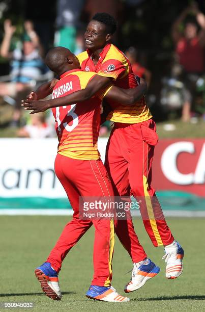Blessing Muzarabani of Zimbabwe celebrates taking the last wicket of Brad Wheal of Scotland during the ICC Cricket World Cup Qualifier between...