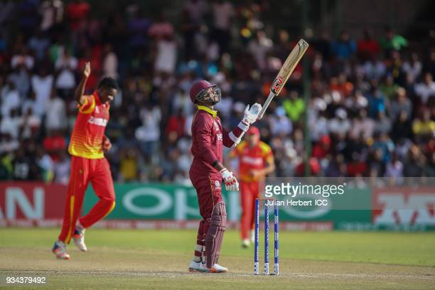 Blessing Muzarabani of Zimbabwe celebrates the wicket of Marlon Samuels of The West Indies during The Cricket World Cup Qualifier between The West...