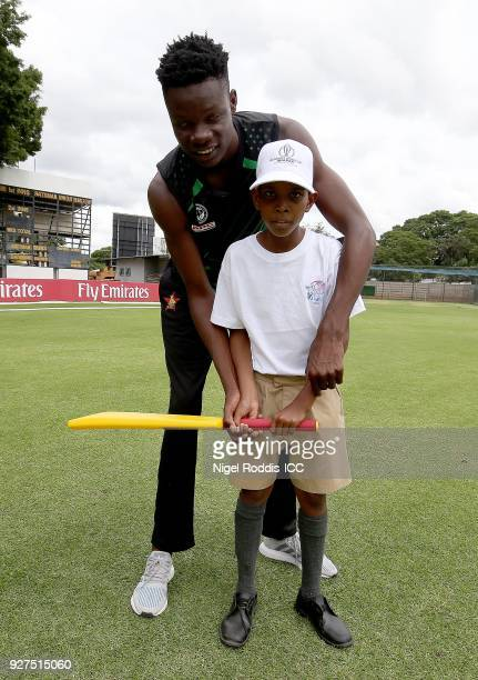 Blessing Muzarabani of Zimbabwe coaching local school children during a 'Cricket for Good' session at Queens Sports Club on March 5 2018 in Bulawayo...