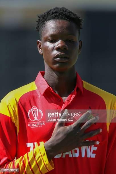 Blessing Muzarabani of Zimbabwe takes part in the national anthem line up during The ICC Cricket World Cup Qualifier between Ireland and Zimbabwe at...
