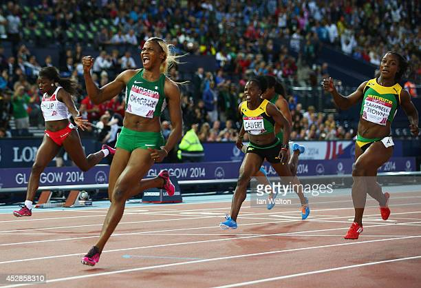 Blessing Okagbare of Nigeria crosses the line to win gold ahead of silver medalist Veronica CampbellBrown of Jamaic in the Women's 100 metres final...