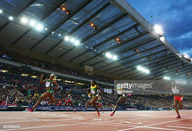 Blessing Okagbare of Nigeria crosses the line to win gold ahead of silver medalist Veronica Campbell-Brown of Jamaic\ in the Women's 100 metres final...