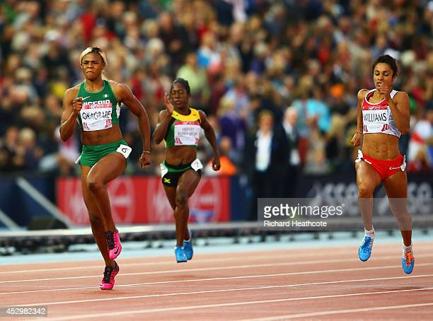 Blessing Okagbare of Nigeria crosses the line to win gold ahead of silver medalist Jodie Williams of England in the Women's 200m Final at Hampden...