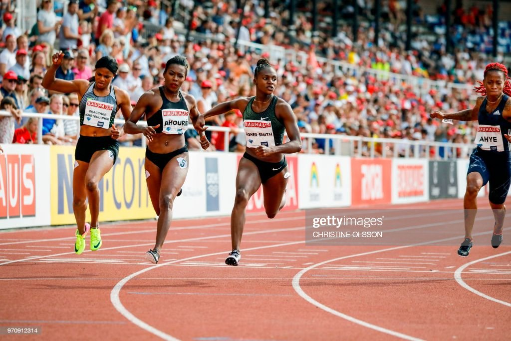 Blessing Okagbare-Ighoteguonor (5th) of Nigeria, Murielle Ahoure (2nd) of Ivory Coast, Dina Asher-Smith (1st) of Great Britain and Michelle-Lee Ahye (3rd) of Trinidad & Tobago compete during the women's 100m event at the IAAF Diamond League 2018 meeting at Stockholm Olympic Stadium in Stockholm, Sweden, on June 10, 2018. (Photo by Christine Olsson / TT News Agency / AFP) / Sweden OUT