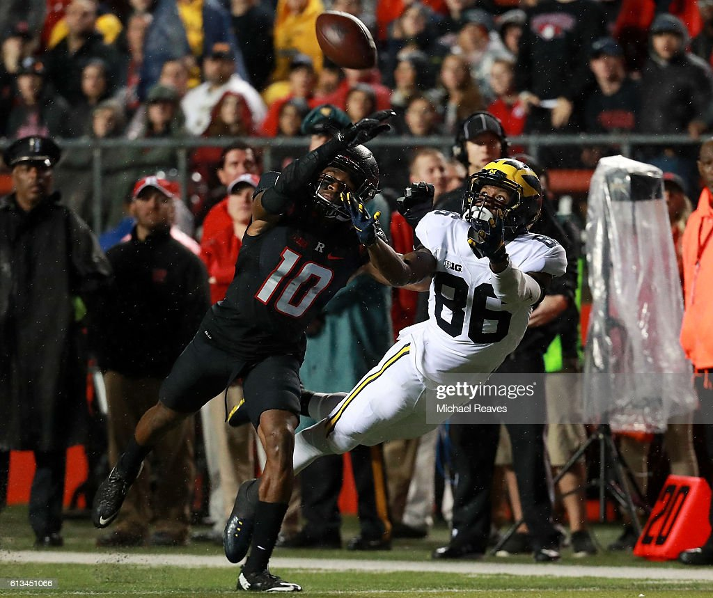 Blessuan Austin #10 of the Rutgers Scarlet Knights breaks up a pass intended for Jehu Chesson #86 of the Michigan Wolverines during the first half at High Point Solutions Stadium on October 8, 2016 in Piscataway, New Jersey.