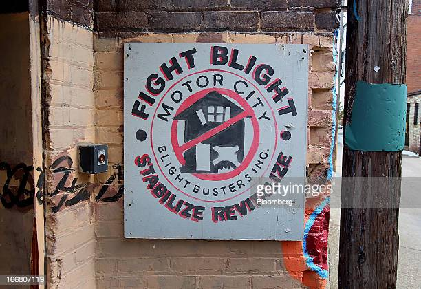 Blight Busters signage is displayed outside of the group's facility in Detroit Michigan US on Saturday March 23 2013 Motor City Blight Busters is a...
