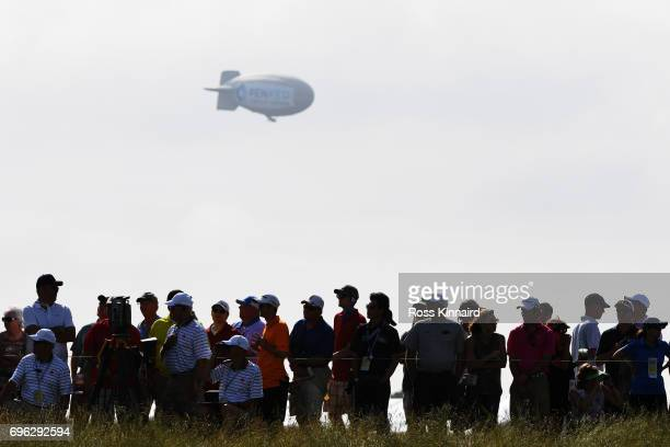A blimp floats over the crowd during the first round of the 2017 US Open at Erin Hills on June 15 2017 in Hartford Wisconsin
