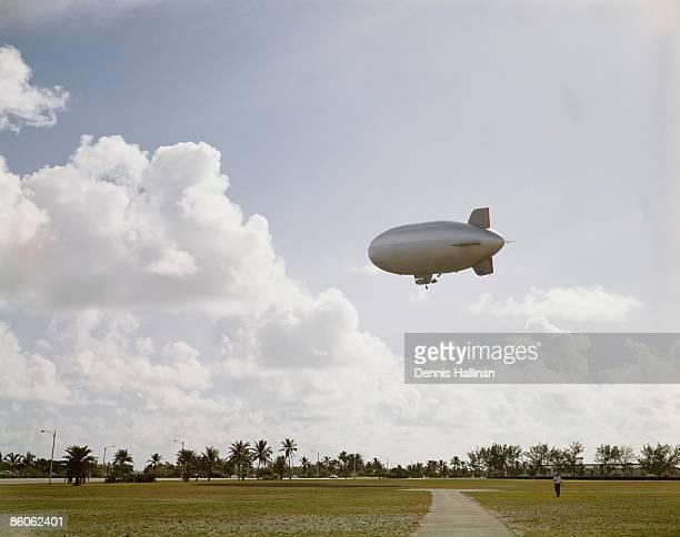 Blimp flying over field