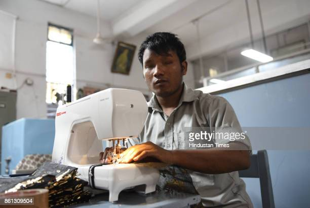 Blind and visually impaired children learn to stitch bags for the upcoming Diwali festival at a vocational training centre run by the Blind Relief...