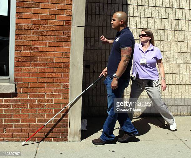 Blind Army veteran Alexander PerezVargas goes on one of the many orientation and mobility walks with the OM specialist Michelle Robinson in Forest...
