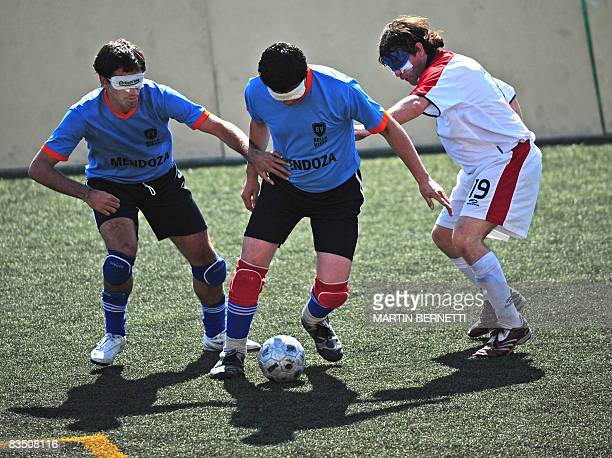 Blind athletes from Chile and Uruguay vie for the ball during their football semifinal match on October 23 2008 in Santiago during the First...