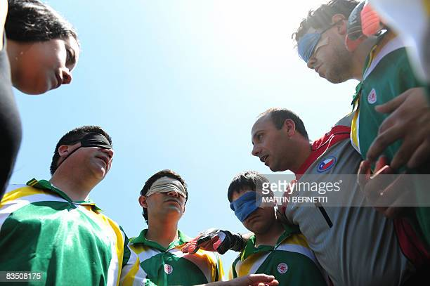 Blind athletes from Chile get ready for their football semifinal match against Uruguay on October 23 2008 in Santiago during the First International...